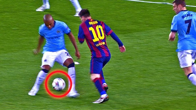 Lionel Messi nutmegs a Manchester City player on his way to scoring a goal