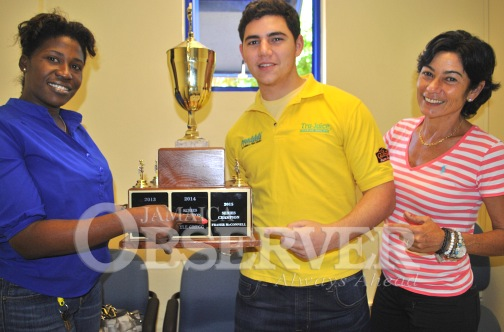 Fraser McConnell (centre), with mother Stephanie collecting his 2015 Jamaica Race Drivers Club (JRDC) Circuit Racing championship trophy from Monique Gibbs, JRDC president. (Photo credit: Jamaica Observer)
