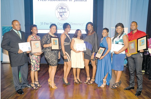 Jamaica Observer representatives (from left) Zaheer Clarke, Jediael Carter, Kimberley Hibbert, Keleshia Powell, Moya Hinds, Anika Richards, Kimone Francis, Javene Skyers and Sherdon Cowan pose with their Press Association of Jamaica (PAJ) awards received at the organisation's National Journalism Awards (Photo credit: Collin Reid)