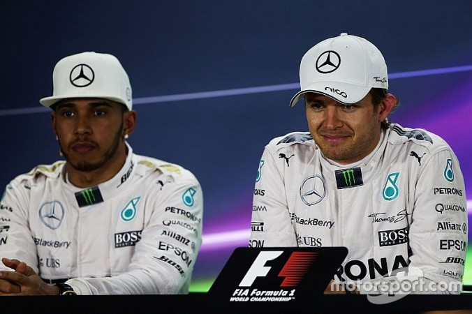 f1-abu-dhabi-gp-2015-second-place-lewis-hamilton-mercedes-amg-f1-and-polesitter-nico-rosbe