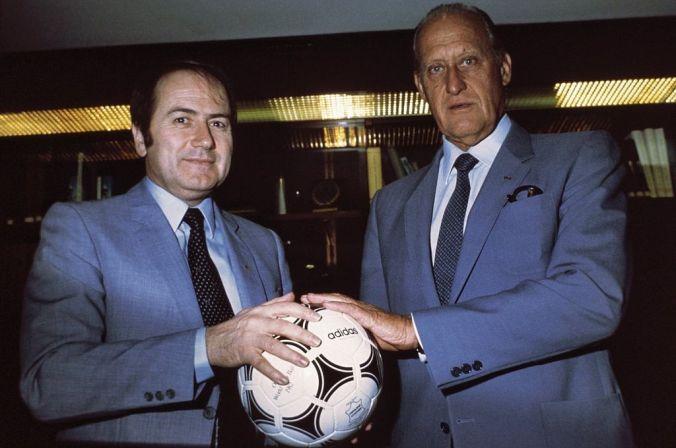 "Joseph ""Sepp"" Blatter, General Secretary of FIFA, and João Havelange, President of FIFA, holding the Adidas Tango España on April 30, 1982"