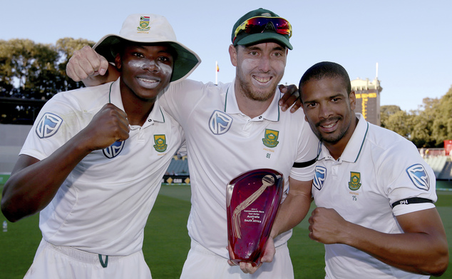 South Africa's Kagiso Rabada, left, Vernon Philander, right, and Kyle Abbott pose with their trophy at the end their cricket test match against Australia in Adelaide, Australia, Sunday, Nov. 27, 2016. Australia win the match while South Africa took the series 2-1. (AP Photo/Rick Rycroft)