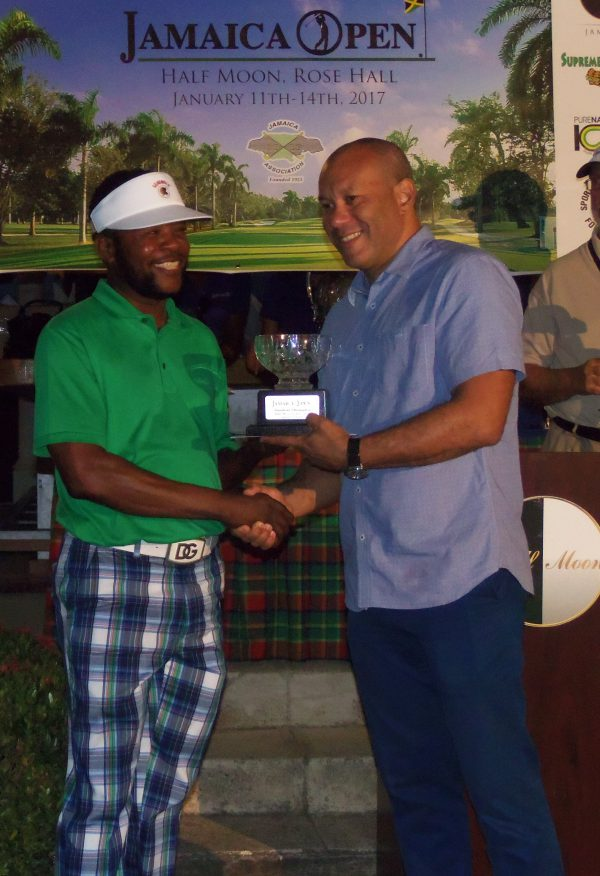 Owen Samuda (left) collects his cheque and trophy as the top-finisher amateur at the 2017 Jamaica Open held at the the Half Moon Golf Course on Saturday January 14, 2017. (Photo: Zaheer E. Clarke)