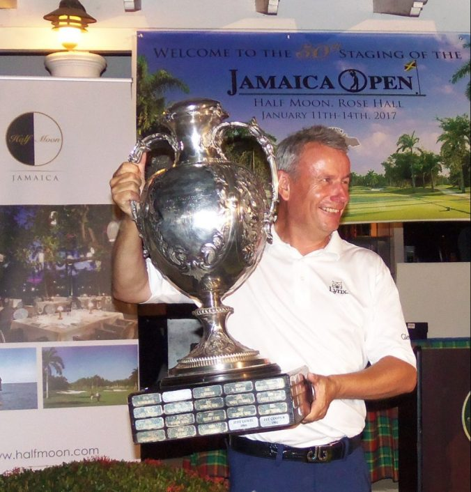 The 2017 Jamaica Open golf champion, Paul Eales hoists the sterling silver championship trophy after winning the 50th staging of the tournament by one shot over the 1993 champion Tom Gillis (Photo: Zaheer E. Clarke)
