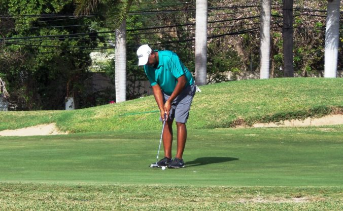 Jamaica's number one local-based amateur, Sean Morris sinks this two-foot putt to finish third among the amateurs after hitting a beautiful chip shot 70 yards out on the 18th hole during the 2017 Jamaica Open golf tournament. (Photo: Zaheer E. Clarke)