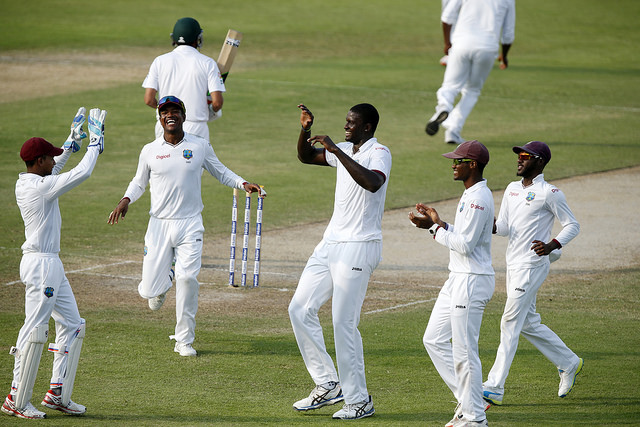 Jason Holder (M) of the West Indies takes the wicket of Younis Khan of Pakistan on day three of the third test between Pakistan and West Indies at Sharjah Cricket Stadium on November 1, 2016 in Sharjah, United Arab Emirates. (Photo by Chris Whiteoak/Getty Images)