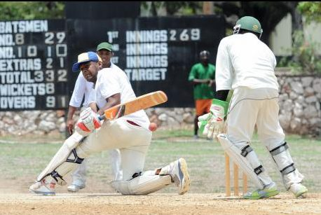 Dennis Bulli of the Jamaica Defence Force plays a shot during a Senior Cup match in 2014 between the Jamaica Defence Force and Melbourne Kangaroos at Up Park Camp. {Photo credit: Ian Allen/Jamaica Gleaner)